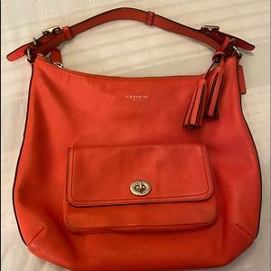 Coach tangerine color coach bag. One size